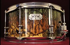 Midnight In the Swamp: 7x14 1/2 inch thick 15 ply Maple shell Dual Pearl Piccolo throw offs Offset double end tube lugs 50/50 45 degree bearing edges Wood burned and stain Gloss lacquer finish Pyrography