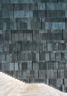 MUMOK Vienna by ortner&ortner basalt lava stone Facade Architecture, Beautiful Architecture, Contemporary Architecture, Stone Facade, Stone Cladding, Facade Design, Wall Design, Facade Pattern, Basalt Stone