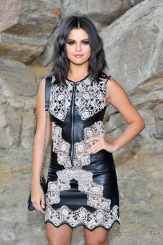 Gomez went for a bold look with her smoky eye and bright pink pout.   - ELLE.com