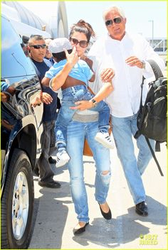 Sandra Bullock arrives on a flight at LAX Airport with her son Louis on July 16, 2013