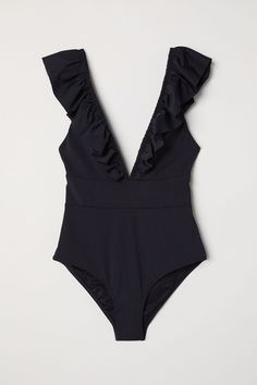 222bfd9cbe Fully lined swimsuit with a low-cut V-neck with gathered flounce front and  back. Seam at waist.
