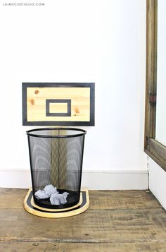 A DIY tutorial to build a wood basketball hoop trash can holder. Make clean up fun and add sports themed decor with free plans for a basketball backboard. Basketball Bedroom, Basketball Hoop, Basketball Backboard, Basketball Awards, Illini Basketball, Basketball Drawings, Fantasy Basketball, Basketball Birthday, Boys Room Decor