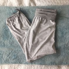LULULEMON Om Pant Capri length lulu om pant, grey with fold over waist. Excellent condition! I love these I just hardly wear them. Size tag removed, purchased as a size 6. lululemon athletica Pants