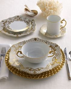 Lacy patterns, hand gilded in gold, embellish white Limoges porcelain dinnerware made entirely by hand in Portugal. Aegean charger with textured gold border coordinates. By L'Objet. Dinnerware Sets, China Dinnerware, Vase Deco, Beautiful Table Settings, Dinner Sets, Dinner Ware, Dinner Plates, China Patterns, Deco Table