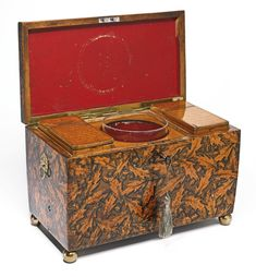 PROPERTY FROM THE AUTOMATA AND MECHANICAL MUSIC COLLECTION OF FRANK AND LORE METZGER, NEW YORK Scottish A VERY RARE SCOTTISH REGENCY PENWORK TWO TUNE MUSICAL SYCAMORE WOOD TEA CADDY SET   CIRCA 1800-1810 SOLD. 14,375 USD