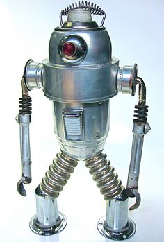 Mr Fog...found object robot sculpture made from a vintage fog generator, kitchen stove burners, v8 auto valve springs, auto interior light, commercial stove legs, auto steering column, furnace burners, bicycle bell, heater spring handle, vintage bicycle tail light, auto transmission parts, and a few other odds and ends.