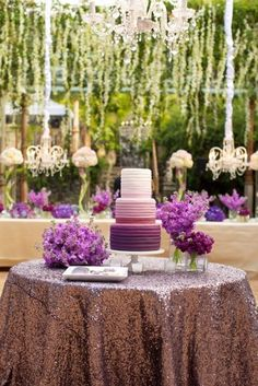 Purple ombre wedding cake on a sparkly table overlay! But gold with the bridesmaids bouquets in vases surrounding