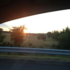 Driving fast taking photos of the Sun setting, Virginia.~House of History, LLC.  copyright, 2012