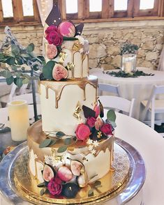 Gold-dripped buttercream cake with fresh flowers and figs by 2tarts Bakery