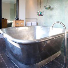 What a perfect size bath-ideal to share a bottle of wine in with your loved one.  Also, hanging baskets for toiletries-great idea!