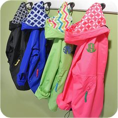These lightweight pullover rain jackets are perfect for keeping in your child's backpack for those unpredictable pop up showers or just a chilly day.  Can be monogrammed front or back and work great with vinyl heat transfer as well.  We love the contrasting fabric on the hood.