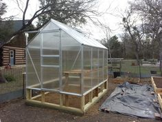 harbor freight greenhouse assembly in the Daddykirbs Garden. The small Harbor Freight greenhouse was added to the garden to help with propagation. 6x8 Greenhouse, Diy Greenhouse Plans, Simple Greenhouse, Backyard Greenhouse, Greenhouse Growing, Greenhouse Wedding, Harbor Freight Greenhouse, Plant Watering System, Vivarium