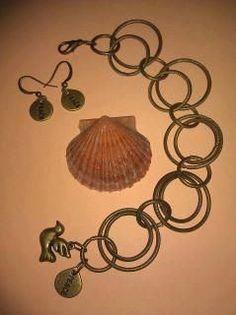 Handmade peace bracelet & earrings set by joannestanley13 on Etsy, $17.00