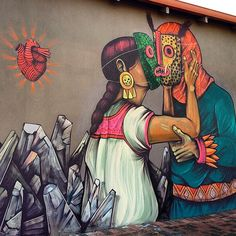 Saner, Perth, Australia. The Mexican muralist dropped this beautiful piece showing the lovely embrace of a couple wearing traditional Mexican masks.