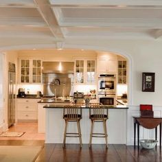 Installing a wider countertop creates an instant eating bar.