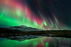Fantastic aurora display over the mountain Høgtuva, Nordland, Norway.