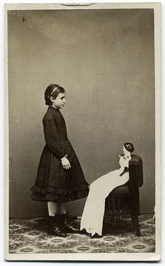 """COME ON!  THIS IS """"ONE ROOM SCHOOL HOUSE PICTURE DAY"""" NOT """"I'M A CREEPY FUCKING DOLL WHO STEALS YOUR SEAT DAY!""""     SERIOUSLY, HORTENCE, I CAN STAND HERE ALL DAY!"""