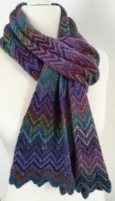 Free Knitting Pattern Zick Zack Scarf- Christy Kamm's scarf is knit with an easy chevron lace pattern. Use two colorways of self-striping or variegated yarn for the most colorful scarf. Pictured project by knispeltante.