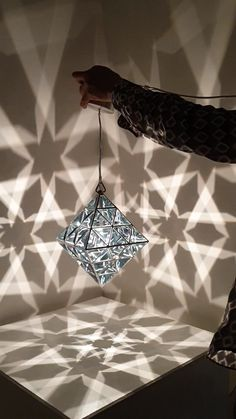lighting design The Vesta, is a glittering, hand-made geometric pendant light, in the shape of anOctahedron. In Sacred Geometry terms, the Octahedronrepresents the element of Air and i