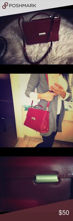 Mandarina duck 🦆 purse Use but in great conditions! Italian ( Venezia) design leather purse!! Clean no stains or peeling or damage! Can be use as hand purse , shoulder or crossbody! Adjustable straps !color red burgundy Mandarina Duck Bags Crossbody Bags