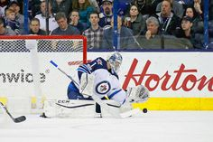 COLUMBUS, OH - APRIL 6: Eric Comrie #1 of the Winnipeg Jets makes a save while making his NHL debut during the game against the Columbus Blue Jackets on April 6, 2017 at Nationwide Arena in Columbus, Ohio. (Photo by Kirk Irwin/Getty Images)