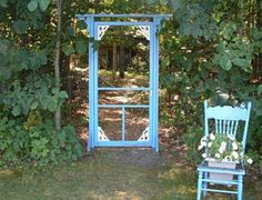 DIY Craft Projects using Old Vintage Windows Doors - Trash to Treasure - Architectural Salvage. Granny uses a bright blue screen door as a garden entrance to her house for her grandkids. Love her idea!