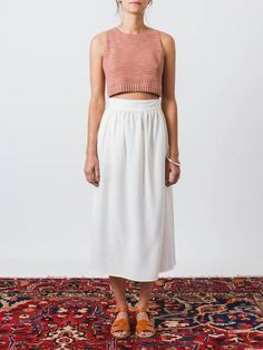 Sleeveless, blush pink tank top in Rachel Comey's hand crocheted stitch featuring a round neck and a ribbed, cropped hem. - Racerback silhouette - Slightly longer in front - Fitted style - 100% combed