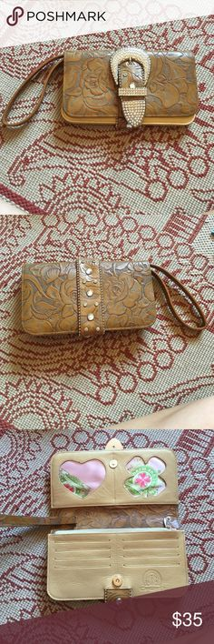 "Charm and luck tan Crystal leather wristlet Gorgeous leather wristlet with embossed for design on it. In great condition, clean inside, very little dirt. Leather is in perfect condition. 8.5"" x 4.5"". Strap is 6"" Charm and Luck Bags Clutches & Wristlets"
