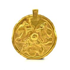 Of high karat gold, the sheet disk embossed with three adorsed reclining ram, centered by a hemispherical knob, the knob outlined in pinched dots, the disk surmounted by a suspension loop. This gold p