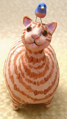 Fat ceramic orange tabby cat sculpture with a by KarenFincannon