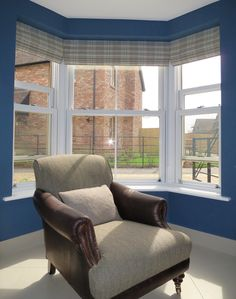 Roman blinds in a bay window Roman blinds in a lovely wool tweed fabric, set beautifully in this bay window.