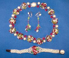 "Louis Rousslet designed this glorious necklace in 1948-1950 for Robert Piguet, Paris. A: The floral volutes, faux pearls, and colored glass beads are typical of his work in this period. 16"" long. B.faux pearl bracelet with the glass bead cluster center is marked ""Made in France"" SOLD., C: The matching drop ear clips (2"" long) SOLD. This is a fabulous parure for any discerning Rousselet collector!"