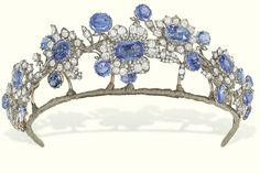 AN ANTIQUE SAPPHIRE AND DIAMOND TIARA   The foliate wreath composed of seven graduated oval-shaped sapphire and old-cut diamond flowerheads applied on a rose-cut diamond branch with sapphire single-stone collet detail, mounted in silver and gold, circa 1850, 17.0 cm wide Barberini Jewels [Appears to be part of a parure, split up for auction]