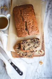 Vegan Banana Bread The best easy vegan banana bread recipe! This healthier vegan banana bread is oil-free and made with applesauce, walnuts, and chocolate chips. Healthy Banana Bread, Banana Bread Recipes, Chips, Chocolate, Desserts, Food, Vegan, Best Bread Recipe, Vegan Banana Bread