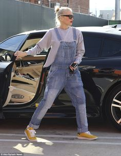 Casual yet stylish: The No Doubt frontwoman was comfortable in a pair of baggy overalls that had patches on both legs and yellow sneakers
