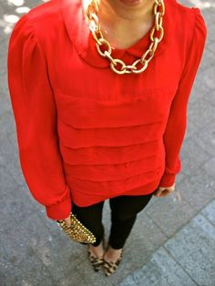 Bright colored shirt with gold bold necklace