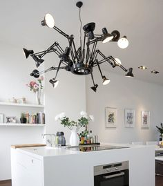 The Dear Ingo light fixture by Ron Gilad is a unique addition to a space. I WOULD LOVE THIS IN MY KITCHEN OR OFFICE.