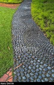 backyard garden paths lead our eye through a garden, and add charm and focus as well. Mosaic Walkway, Pebble Mosaic, Mosaic Garden, Stone Mosaic, Pebble Walkway Pathways, Paver Walkway, Flagstone Patio, Path Design, Landscape Design