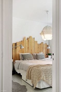 Bedroom with nice details via the blog Trendenser. This is a cool, different headboard. Adds character to the room