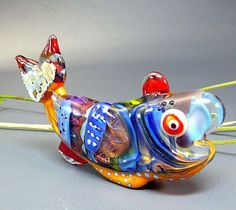 The Fish with the Silver Tail  - handmade lampwork glassbead by Manuela Wutschke. $150.00, via Etsy.