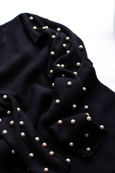 Check out how you can create a chic pearl studded sweater with this quick + easy DIY. #partner