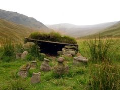 """The Tigh na Cailleach, in a remote glen west of Glen Lyon, it's a small turf-roofed """"house"""" which is home to a """"family"""" of water-worn stones known as the Cailleach (old woman), the Bodach (old man), the Nighean (daughter) Cairns, Glen Lyon, British Isles, Mother Goddess, Ancient History, Great Britain, Archaeology, Places To Go, Beautiful Places"""