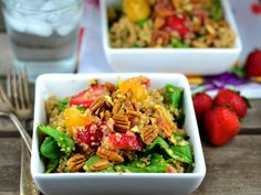 One bowl meal salad with fresh baby spinach, sweet strawberries and nutty quinoa with a tangy balsamic dressing.