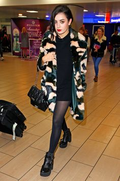 The Dos & Don'ts Of Travel Style #refinery29 http://www.refinery29.com/travel-fashion#slide9 Do consider your socks. Compression tights and thick socks can help you keep swelling down during long flights, and they can become a lot more comfortable to wear than stiff jeans.Charli XCX at Glasgow Airport in Glasgow.