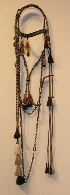 Territorial prison-made, multicolored hitch-braided horse hair bridle with closed reins and attached romal.