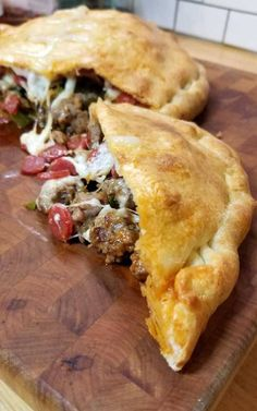 This Meat Lovers Gameday Calzone has all the fixings of a cheesy supreme pizza in a Football Calzone form. Fun to make and even more fun to eat! Perfect for a Super Bowl party or any gameday for that matter! Meat Recipes, Dinner Recipes, Cooking Recipes, Sushi Recipes, Dinner Ideas, Italian Dishes, Italian Recipes, Italian Foods, Sandwiches
