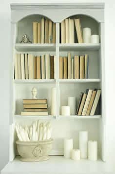My #1 rule for decorating is turning books backwards when using them as decorating elements....this is also the #1 thing guests comment on when they come to my house.  The practice pretty much makes everyone else's head explode.  Oh well!