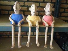 Ceramic men, 3 op een rij.