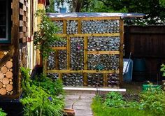 Greenhouse made out of glass jars - includes water catchment system.