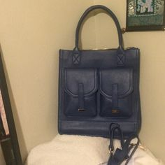 """Erica Anenberg Madison leather Crossbody purse Dual top rolled handles  - Detachable and adjustable shoulder strap - Top zip closure - Exterior features 2 front flap pockets and back zip pocket - Interior features zip wall pocket, padded laptop sleeve, and 2 media pockets - Dust bag included - Approx. 15"""" H x 10"""" W x 5"""" D - Approx. 20"""" handle drop, 44-47"""" strap length - Imported Materials: Genuine cowhide leather exterior, cotton lining.   Has a small approx 2"""" mark on the inside of the…"""